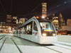 METRORail three quarter view in night scene